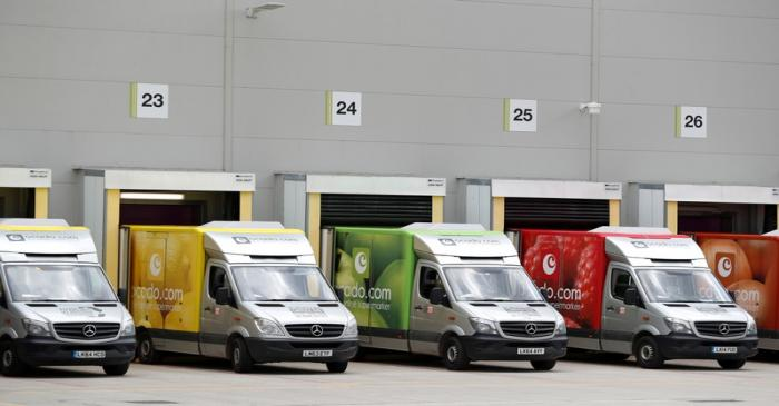 FILE PHOTO: Delivery vans are lined up prior to dispatch at the Ocado CFC (Customer Fulfilment