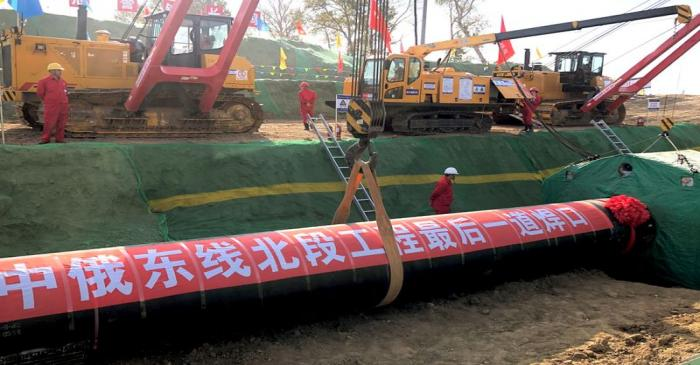 FILE PHOTO: Workers are seen at the construction site of a natural gas pipeline as part of
