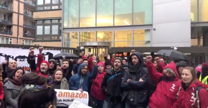 Demonstrators take part in a protest outside Amazon's French headquarters in Clichy