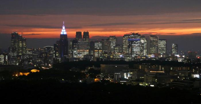 FILE PHOTO :High-rise buildings are seen at the Shinjuku business district during sunset in