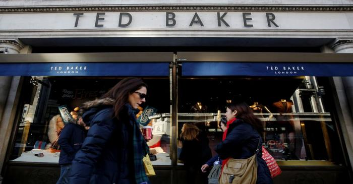 Shoppers walk past a Ted Baker store on Regents Street in London