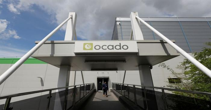 A man walks from the main reception of the Ocado CFC (Customer Fulfilment Centre) in Andover