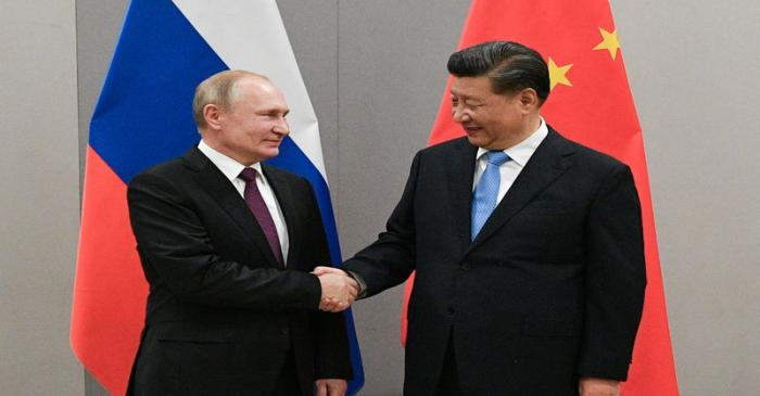 Russian President Putin meets with Chinese President Xi during their meeting on the sideline of