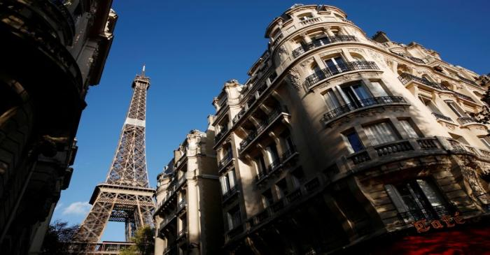 FILE PHOTO: The Eiffel Tower stands near luxury Haussmannian buildings in the 7th