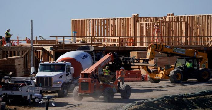 Work crews construct a new hotel complex on oceanfront property in Encinitas, California