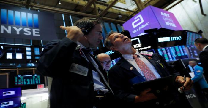 Traders work on the trading floor at the New York Stock Exchange (NYSE) at the opening of the