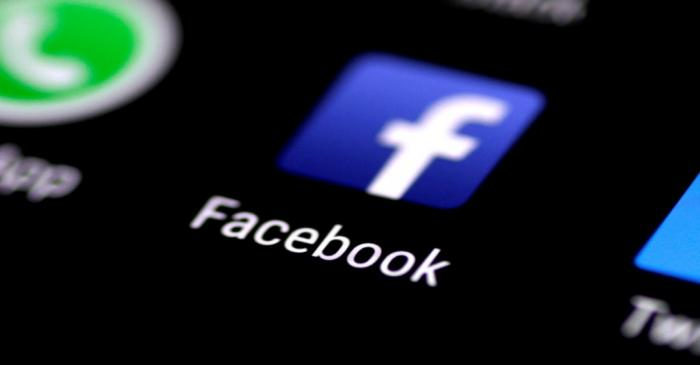 FILE PHOTO: The Facebook application is seen on a phone screen