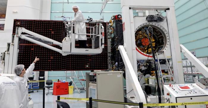 FILE PHOTO: Technicians work on the Inmarsat S-Band/Hellas-Sat 3 satellite in the clean room