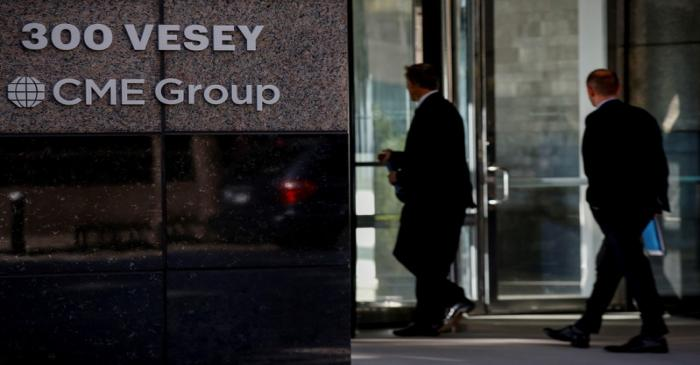 Men enter the CME Group offices in New York