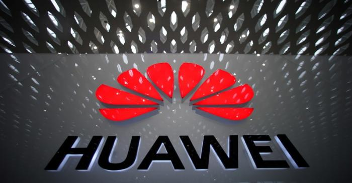 A Huawei company logo is pictured at the Shenzhen International Airport in Shenzhen