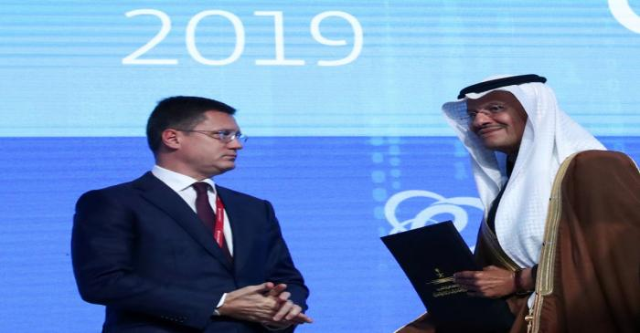 FILE PHOTO: Saudi Energy Minister Bin Salman and Russian Energy Minister Novak attend the