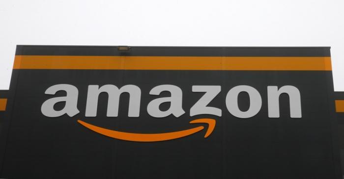 The Amazon logo is seen at the Amazon fulfilment center in Bretigny-sur-Orge near Paris
