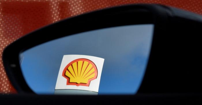 FILE PHOTO: A Shell logo is seen reflected in a car's side mirror at a petrol station in west