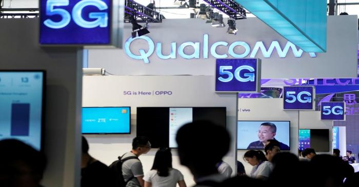 FILE PHOTO: Signs of Qualcomm and 5G are pictured at Mobile World Congress (MWC) in Shanghai
