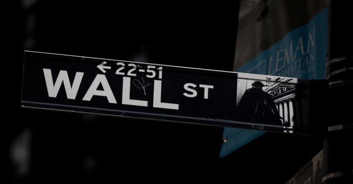 A Wall St. street sign is seen near the NYSE in New YorkNYSE in New York