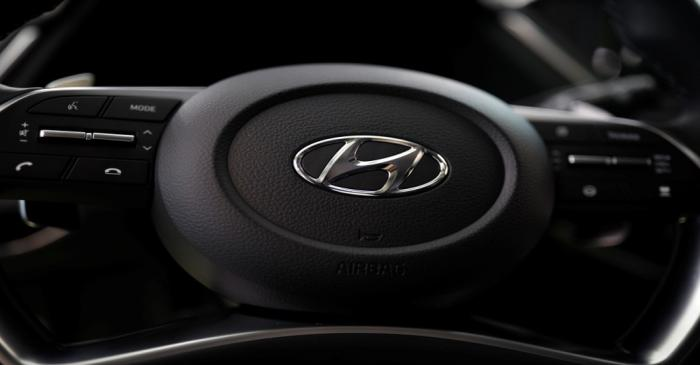 The logo of Hyundai Motors is seen on a steering wheel of a all-new Sonata sedan on display at