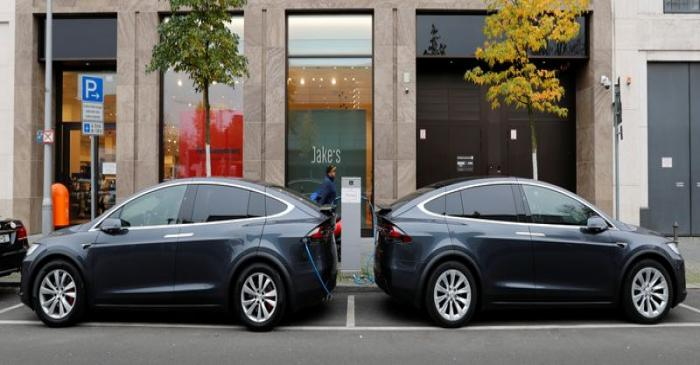 Tesla Model X electric cars recharge their batteries in Berlin