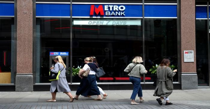 FILE PHOTO: People walk past a Metro Bank in London, Britain