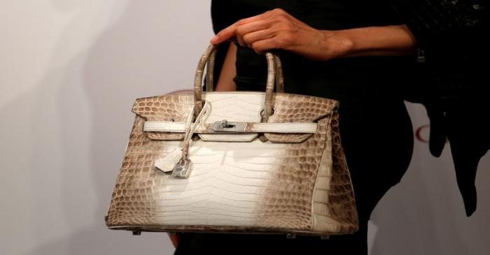 FILE PHOTO: A model carries a Hermes signature Birkin with Himalayan crocodile leather during a