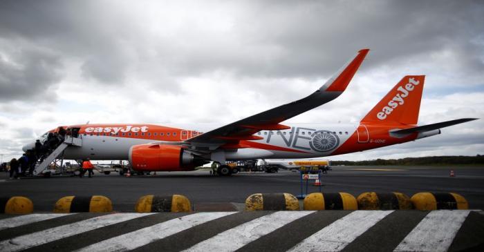 Passengers board an easyJet plane at the Nantes-Atlantique airport in Bouguenais near Nantes