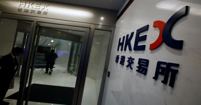 The name of Hong Kong Exchanges and Clearing Limited is displayed at the entrance in Hong Kong