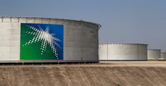 FILE PHOTO: A view shows branded oil tanks at Saudi Aramco oil facility in Abqaiq