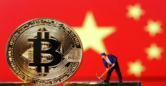 FILE PHOTO: Picture illustration of a small toy figurine and representations of the Bitcoin