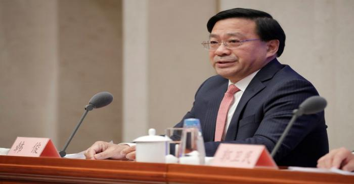 Chinese Vice Minister of Agriculture and Rural Affairs Han Jun attends a news conference on the