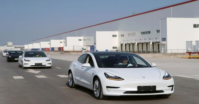 China-made Tesla Model 3 vehicles are seen at the Shanghai Gigafactory of the U.S. electric car