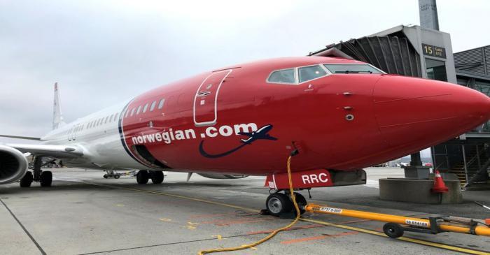 A Norwegian Air plane is refuelled at Oslo Gardermoen airport