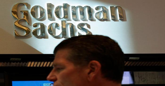 A trader works inside the Goldman Sachs stall on the floor at the New York Stock Exchange
