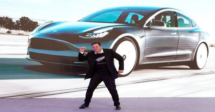 Tesla Inc CEO Elon Musk dances onstage during a delivery event for Tesla China-made Model 3