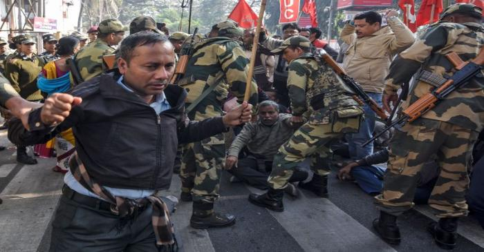 Activists of the Centre of Indian Trade Unions are detained during an anti-government protest
