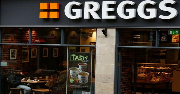 FILE PHOTO: People sit inside a Greggs bakery in Bradford, Britain