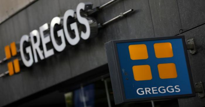FILE PHOTO: Signage and logo are pictured outside a branch of Greggs in Liverpool