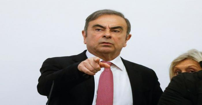 Former Nissan chairman Carlos Ghosn gestures during a news conference at the Lebanese Press