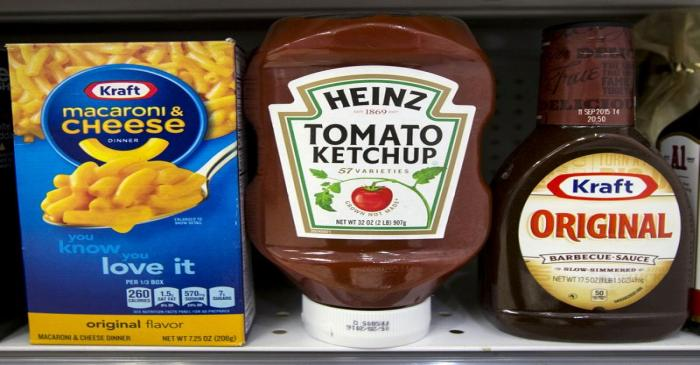 FILE PHOTO: A Heinz Ketchup bottle sits between a box of Kraft macaroni and cheese and a bottle
