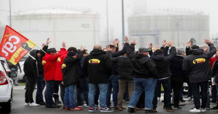 Workers of French oil giant Total gather in front of the oil refinery in Donges