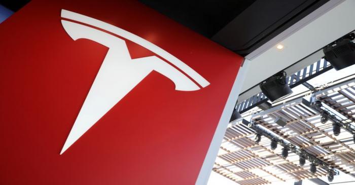 FILE PHOTO: A Tesla logo is seen in Los Angeles