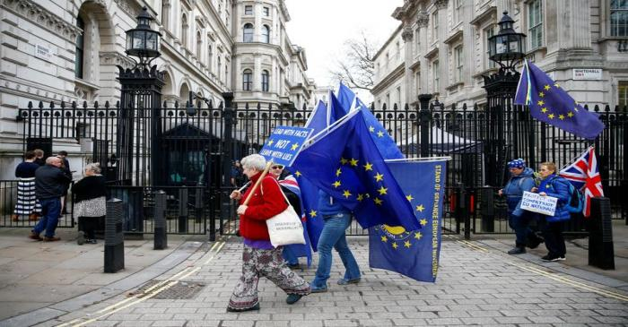Anti-Brexit protesters are seen in front of Downing Street in London