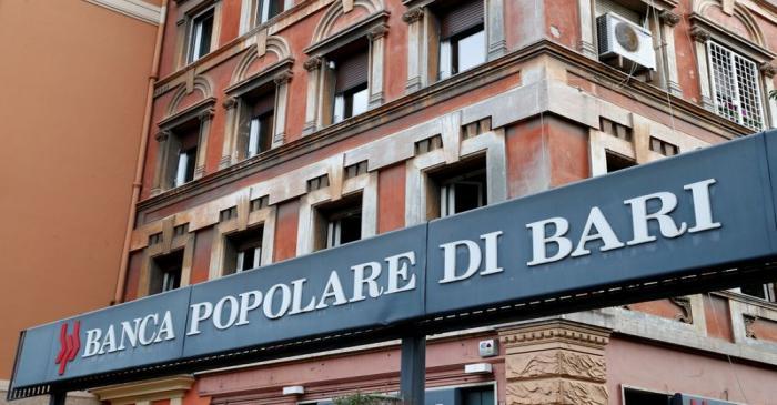 FILE PHOTO: The logo of Banca Popolare di Bari bank is pictured outside the company's branch