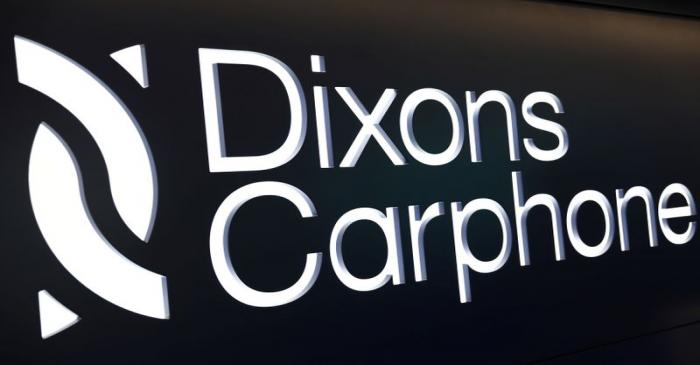 A sign displays the logo of Dixons Carphone at the company headquarters in London