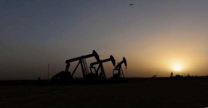 Pump jacks operate at sunset in Midland