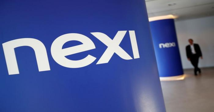 FILE PHOTO: The logo of Italian payments group Nexi is pictured inside their headquarters in