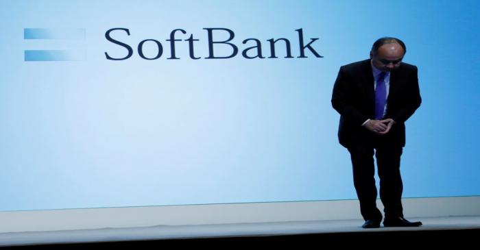 FILE PHOTO: Japan's SoftBank Group Corp Chief Executive Masayoshi Son bows his head after his