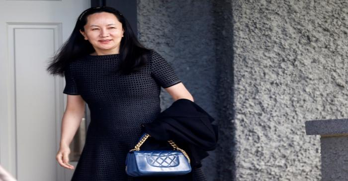 FILE PHOTO: Huawei's Financial Chief Meng Wanzhou leaves her family home in Vancouver, British
