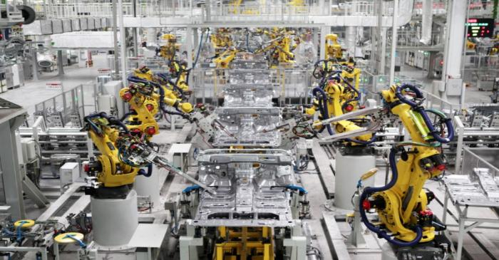 Robotic arms are seen on a vehicle production line at a production base of Great Wall Motors in