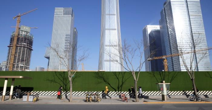People walk in Beijing's central business area