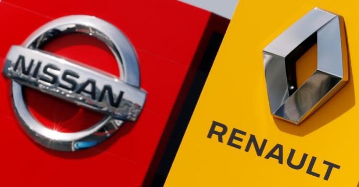 The logos of car manufacturers Renault and Nissan are seen in front of dealerships of the