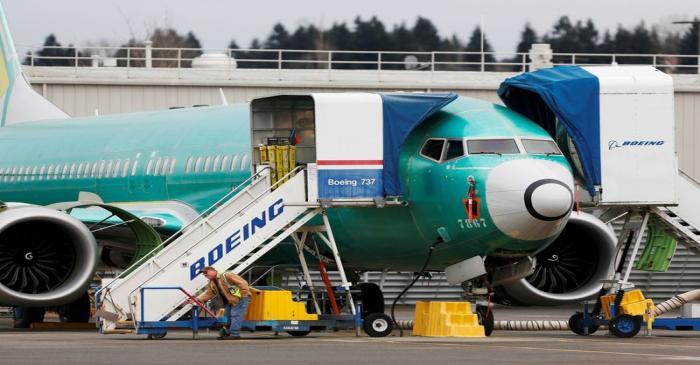 FILE PHOTO: An employee works near a Boeing 737 Max aircraft at Boeing's 737 Max production